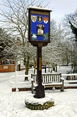 A wintry scene of the village sign at Rolleston on Dove, Staffordshire, England. Link to Signs Gallery.